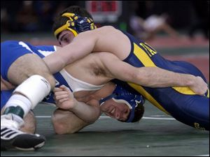 Anthony Wayne's Caleb Metcalf, bottom, tries to get control of Olmsted Falls' Ryan Smith in the semifinals. Metcalf lost 8-4.