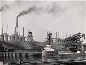 An ore carrier sails up the Cuyahoga River past the Republic Steel Corp. plant in Cleveland in 1949.