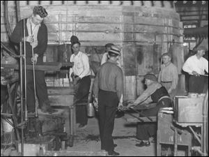Workers man a furnace at Toledo's Libbey Glass in 1938 as Ohio climbed out of the Depression.