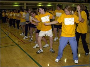 cty photo by don simmons mar 1, 2003  corey miller ( white shorts )  and jenny meyer ( blue sweats ) along with many others attend the dance marathron held at the university of toledo student rec center to raise money for the  children's miracle network