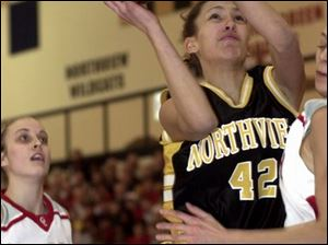 Northview's Niki McCoy scores two of her 12 points against Central Catholic last night.