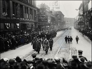 Returning troops parade down St. Clair Street from Adams Street toward Madison Street in Toledo on April 10, 1919.