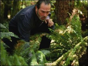 Tommy Lee Jones protrays a former survival instructor.