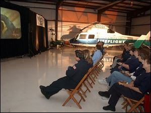 Emergency personnel watch the program at the Sandusky County Regional Airport.