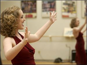Katie Knipp of Kansas City, at left, sings during her audition.