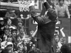 Val Glinka cuts down the nets after his St. Francis team won Toledo's first title in 1983.