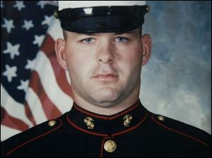 Cpl. Lance Kokensparger sustained a broken neck in an auto accident in 2001.