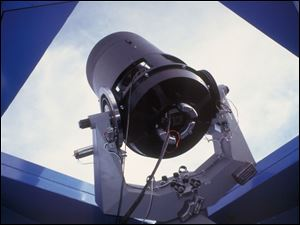 Carl W. Akerlof, a physicist at the University of Michigan, uses two optical telescopes like this one to track the afterglow of an enormous gamma-ray blast.