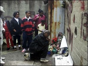 Prayers were offered April 15, 2001, where the teen was killed in Cincinnati's Over-the-Rhine district.