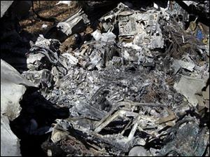 The burned-out cockpit is among the wreckage in Oak Openings.