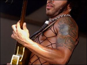 "Lenny Kravitz offers (""We Want Peace); as a protest song."