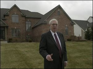 Bill LeStrange has had his Sylvania Township house, behind him, on the market since August, 2001, and has decreased the asking price.