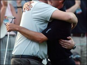 Canadian Mike Weir, right, celebrates with his father, Rich, after winning the Masters over Len Mattiace in a one-hole playoff.