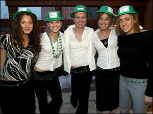 IRISH SMILES: From left, Erin Kander, Katie Skelton, Emily Werner, Maggie Herrick, and Caroline Stoy pause for a pose at St. Ursula's 'Sham-rockin' Good Time.'