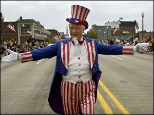 Uncle Sam, portrayed by Dave Lyke of Monroe, marches in the parade there.