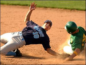 Montpelier second baseman Jose Salazar reaches back in the 10th inning in an attempt to tag Newark Catholic runner Chris Wohlhelter, who scored the winning run.