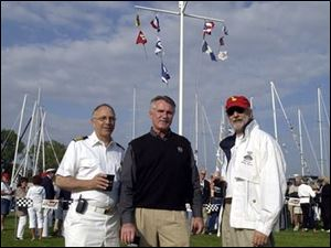 GETTING READY: Jack Pozsik, Alan Wise, and Ron Soka at the pre-race party at the Toledo Yacht Club.
