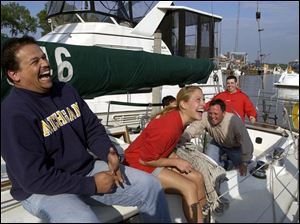 LAUGHS ON THE LAKE: Having a blast aboard the Irish Mist, a 41-foot Morgan, are, from left, Moustafa El Baradie, Laura Jelsone, Gary Williams, and Jasen Hager, all members of the Detroit Edison Boat Club.