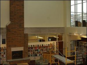 The library was closed for more than a year for a $5.7 million renovation and expansion project that included replacing its flat roof with one that is pitched.