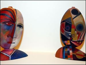 Tom McGlaughlin used glass and coloroed pencil to create these.
