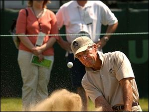 Gary Player shows some of the 21,000 who watched the pros practice at Inverness how an expert gets out of the sand.