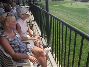 Jennifer Kasee and her mother, Carole Mack, view the 18th hole from the clubhouse.