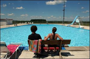 Lifeguards watch the Holgate Community Pool, which has received complaints of head lice.