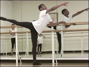 Alexander Catchings, 15, demonstrates an action pose in the Toledo Ballet studio.