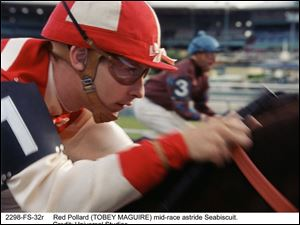 Tobey Maguire at jockey Red Pollard.