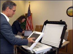 An electronic voting system designed by Diebold Elections Systems of North Canton, Ohio, gets a tryout as it arrives at the Lucas County Board of Elections. Besides those delivered last week, 445 more are expected to arrive by the end of the month.