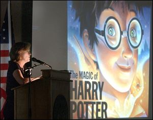 `It could have been anyone illustrating this book, and I'm lucky I said yes,' Mary GrandPr  tells a crowd of nearly 300 at the University of Findlay. Ms. GrandPr , who lives in St. Paul, has illustrated the five U.S. editions of the popular Harry Potter series by J.K. Rowling.