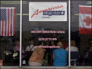 People wait inside the American Drug Club in Livonia, Mich., hoping to get a better price on prescription drugs. The club offers cheaper, government-subsidized prescription drugs from Canada via American Drug Co. of Winnipeg, Canada.