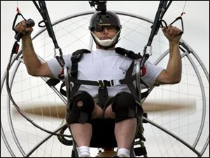 John Phillips of Reading, Pa., does a low-level flyover as he videotapes his flight with a helmet-mounted camera.
