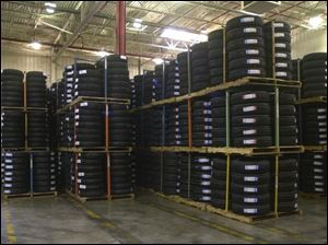 Cooper Tire, owner of this Findlay warehouse, is focusing more on performance models.