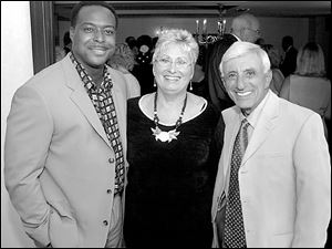 Jamie Farr, right, with his personal assistant, Sharon Toth, and CNN anchor Leon Harris during the Owens Corning Gala preparty at the Radisson Hotel.