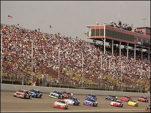 Thousands of fans watched yesterday's Busch Series race, and many more will watch today's Winston Cup race. But NASCAR officials are trying to attract more minorities.