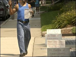 cty protest21p 1 August 21, 2003. Danny Clark of Fresh Attitude, Inc., protests the unfair distibution of funds to the minority Alcohol and Drug Treatment Centers at One Government Center Thursday afternoon. Blade photo by Jeremy Wadsworth