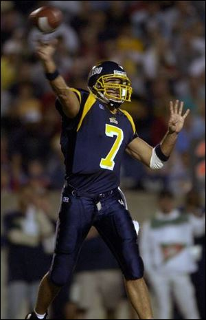Sophomore Bruce Gradkowski completed 49 of 62 passes for 461 yards and three TDs.