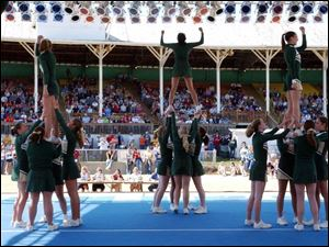 Cheerleaders from Christi Catholic High School in Jackson, Mich., perform during the cheerleading competition.