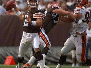An offensive lineman protects Cleveland quarterback Tim Couch as he stands in the pocket. Couch completed 23 of 36 passes for 280 yards and two touchdowns.
