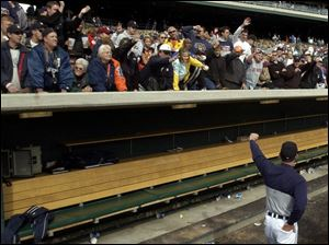 Manager Alan Trammell waves to loyal Tigers fans who showed more support than disgust during the final week.