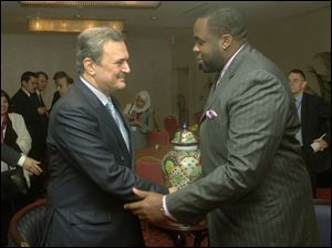 Prince Saud al-Faisal, Saudi Arabian foreign minister, left, is greeted by Mayor Kwame Kilpatrick in Detroit. Prince al-Faisal spoke yesterday at a Renaissance Center seminar.