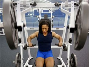 Maya Stone works out at a fitness club. If she reaches her goal of becoming a professional body builder, she can earn business and product endorsements, conduct guest appearances, and win prize money for competitions.