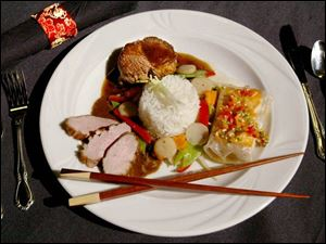 A trio of Asian-inspired entrees will be served at the ball. Clockwise from top, Beef Fillet with Soy Mustard Glaze, Salmon in Crisp Rice Paper, and Sliced Duck Breast with Zinfandel Sauce.