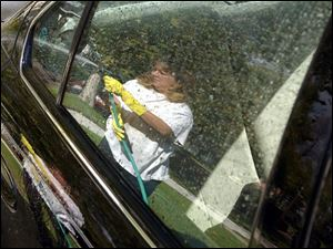 ROV CAR WASH 10/23/03 PHOTO BY LORI KING Toledoan Jennifer Johnson was going to wash her car at a car wash but decided the day wasn't as cold as she thought, as long was the sun was shining, so she washed it in her Ogden Ave. driveway.