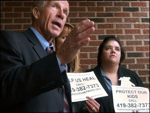Attorney Jeff Anderson, Barbara Blaine, and Claudia Vercellotti, from left, discuss the lawsuit filed yesterday during a news conference in front of the Catholic diocese's offices.