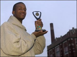 Jeremy Crawford won a trophy in a poetry contest, a feat that goes hand-in-hand with his rapping ability.