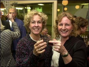 HERE'S TO OENOPHILES: Pam Haley and Mari Davis lift secret spirits at the Vineyard to benefit the Sight Center.