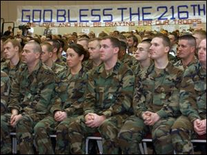 Members of the 216th Engineer Battalion, Company C, listen to speakers at a send-off ceremony held yesterday.