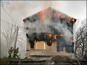 CTY champlain 01 - Toledo firefighters battle a vacant house fire on Champlain St, in which two firefighters were injured. The Blade/Allan Detrich